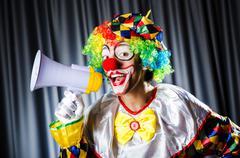 Clown in studio with loudspeaker Stock Photos