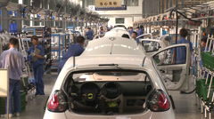 Robot lowers car body in production line Stock Footage