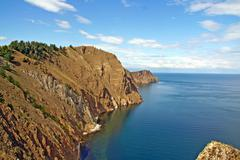 tip of olkhon island surrounded by lake baikal, russian siberia - stock photo