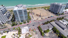 Aerial video of a beachfront construction site Surfside Stock Footage