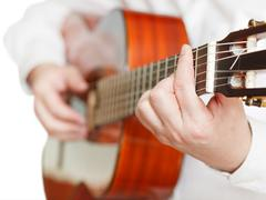 Man playing classical guitar close up isolated Kuvituskuvat