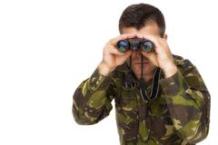 Army soldier looking through binoculars isolated on white background Stock Photos