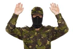 Soldier surrenders isolated on white background Stock Photos