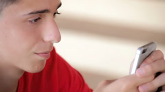 Teenager writing messages on the smartphone (close up) Stock Footage