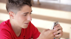 Teenager writing messages on the smartphone Stock Footage