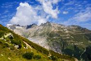 Stock Photo of view through alps valley near gletch with furka pass mountain road, switzerla
