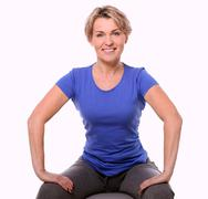Cute and smiling middle aged woman with abs ball Stock Photos