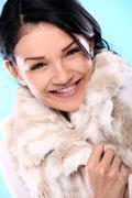 Beautifull smiling young girl in fur Stock Photos