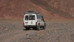 Jeep passage in the rocky desert near Hurghada, Egypt Stock Footage
