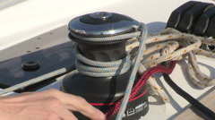 Sailor maneuvering on winch  Stock Footage