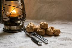 set with some walnuts, a nutcracker and a lantern - stock photo