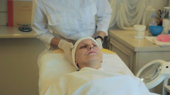 Patient takes facials - rejuvenating mask - stock footage
