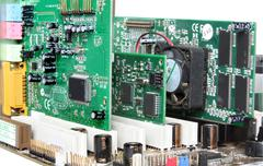 computer hardware. motherboard with video card, sound card - stock photo