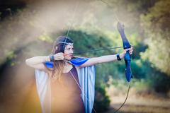 elven wood princess with bow and arrow - stock photo