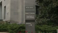 Stock Video Footage of Department of Justice Building & Sign (Slow Zoom Shot)