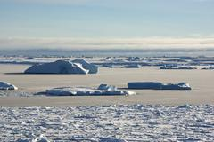 strait between the islands of the antarctic ice-covered and shugoy winter. - stock photo