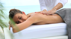 Beautiful woman relaxing on a massage bed Stock Footage