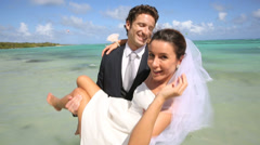 Just married couple having fun at the beach Stock Footage