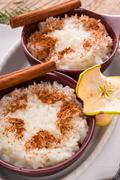 milk rice with cinnamon and applesauce - stock photo