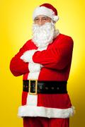Stock Photo of Confident male Santa posing with arms folded