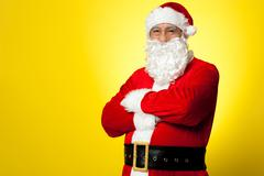 Stock Photo of Saint Nick posing confidently against yellow background