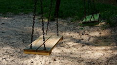 Two moving swings. - stock footage