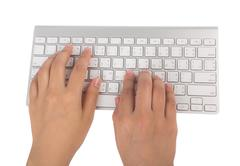 Closeup of business woman hand typing on laptop keyboard (with clipping work  Stock Photos