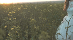 Confident Young Woman Bride Dress Walking Sunset Summer Field Stock Footage