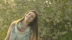 Pretty Casual Hippy Woman Scarf Enjoying Spring Petals Wind Stock Footage