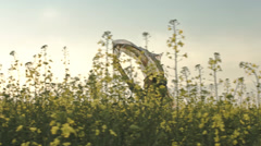 Young Beautiful Vintage Woman Running Through Rapeseed Field - stock footage