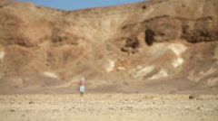 People walking in the desert Negev - stock footage