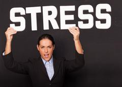 Businesswoman with the word STRESS Stock Photos