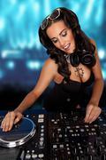 Sexy curvy DJ mixing music - stock photo