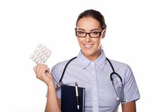 Stock Photo of Beautiful doctor dispensing tablets