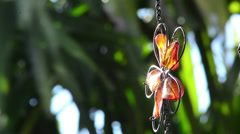 shinning orange cristal flower hanging from roof - stock footage