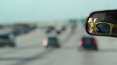 yellow glasses driving over the express way miami 02 - stock footage
