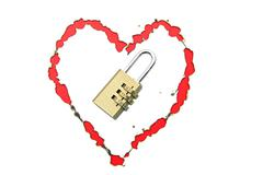 Stock Photo of paper with burnt in heart shape with pad lock concept