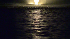 yellow iluminated fountain on the middle of a lake 03 - stock footage