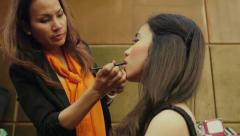 4of4 Make-up artist working with young woman, girl, beauty treatment - stock footage