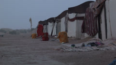 Tents in the desert during a sand storm Stock Footage