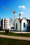 Chapel of st. vladimir and house under construction Stock Photos