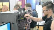 Stock Video Footage of operator during film restoration during NAB Show 2014 in Las Vegas, USA.