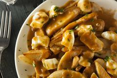 Unhealthy delicious poutine with french fries Stock Photos