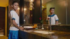 4of5 Asian maid cleaning hotel bathroom, woman, people working, jobs Stock Footage
