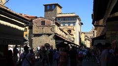 Crowd of People in the shadows walk on the Ponte Vecchio Bridge Stock Footage