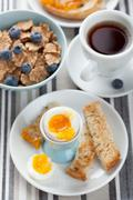 healthy breakfast with egg and cornflakes - stock photo