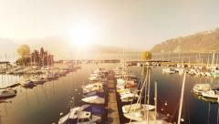 Magic hour sunset. aerial view.water lake.sailboats dock pier.panorama horizon Stock Footage