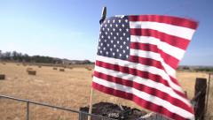 American Flag Waving in a Hay Field at 240fps Stock Footage