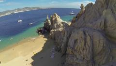 Flight over rock formations in a beach of Cabo - stock footage