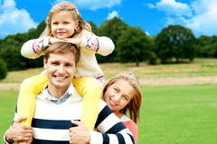 Stock Photo of Happy smiling family outdoors